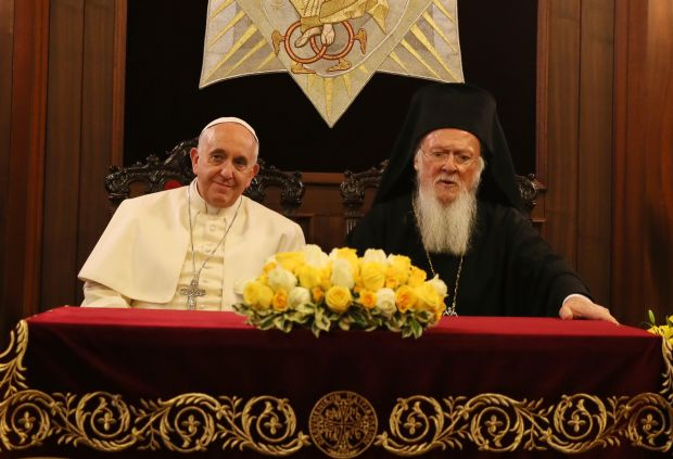 Pope Francis and Ecumenical Patriarch Bartholomew of Constantinople sit during signing of joint declaration at the patriarchal Church of St. George in Istanbul Nov. 30. (CNS photo/Grzegorz Galazka, pool) See POPE-REFUGEES Nov. 30, 2014.